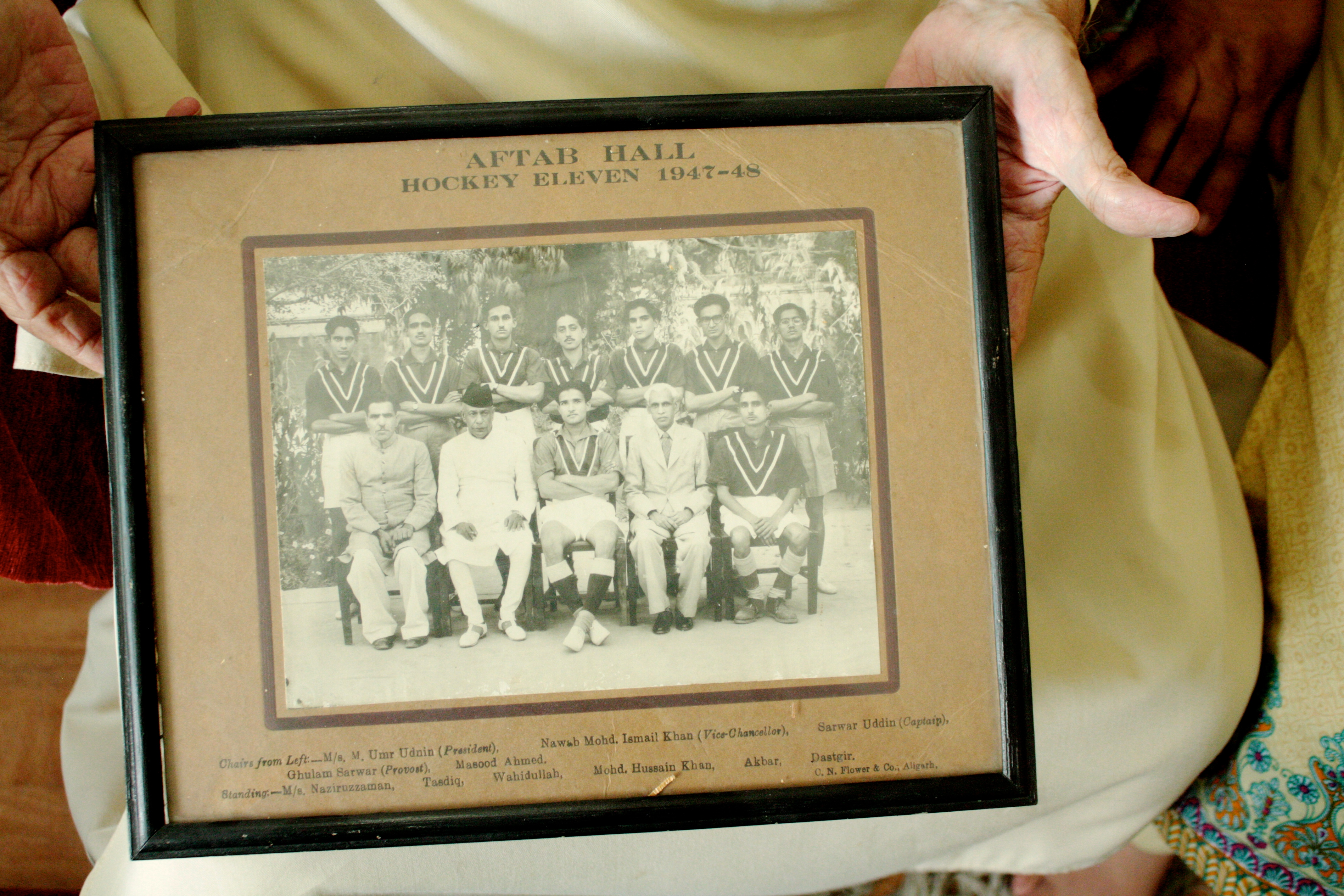 Framed photographs of the Hockey Club at Aligarh Muslim University- brought with a young boy when he migrated from Aligarh to Lahore in 1953